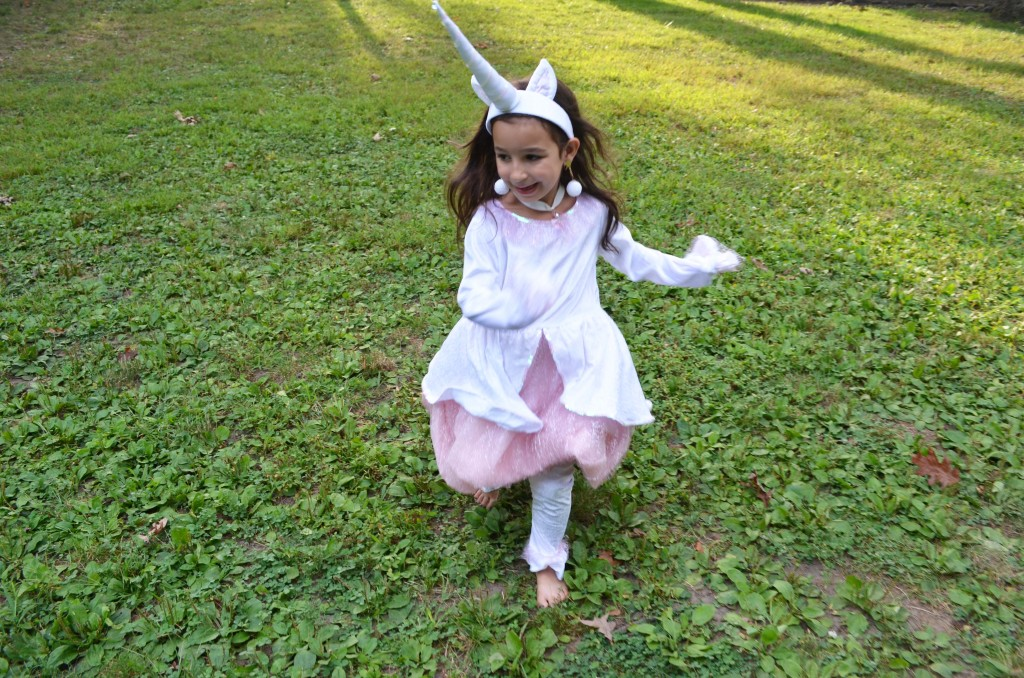 unicorn costume chasing fireflies girls