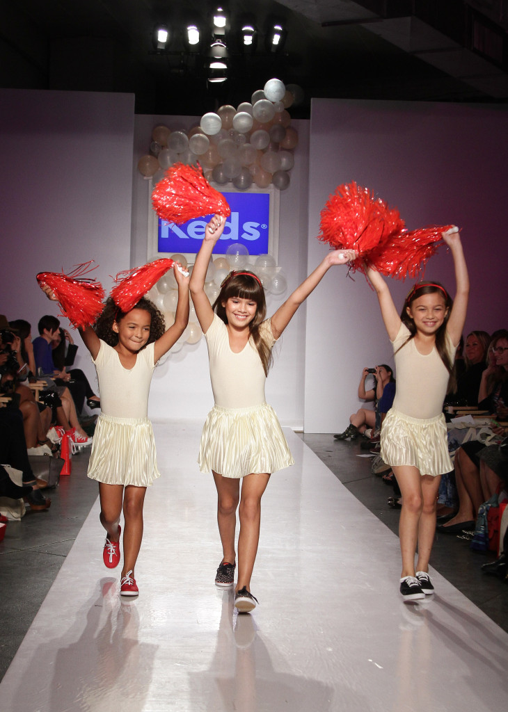 This playful trio cheered down the runway in classic Keds in red, navy and white colors.