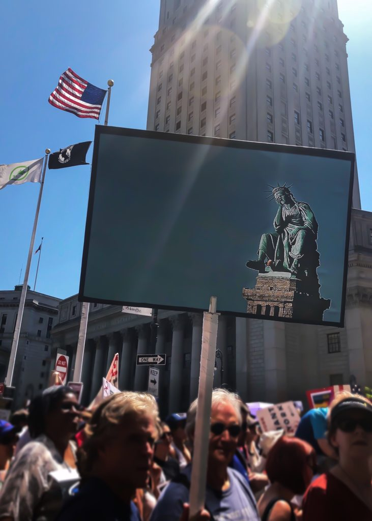 protest_sign_weeping_Statue_of_Liberty