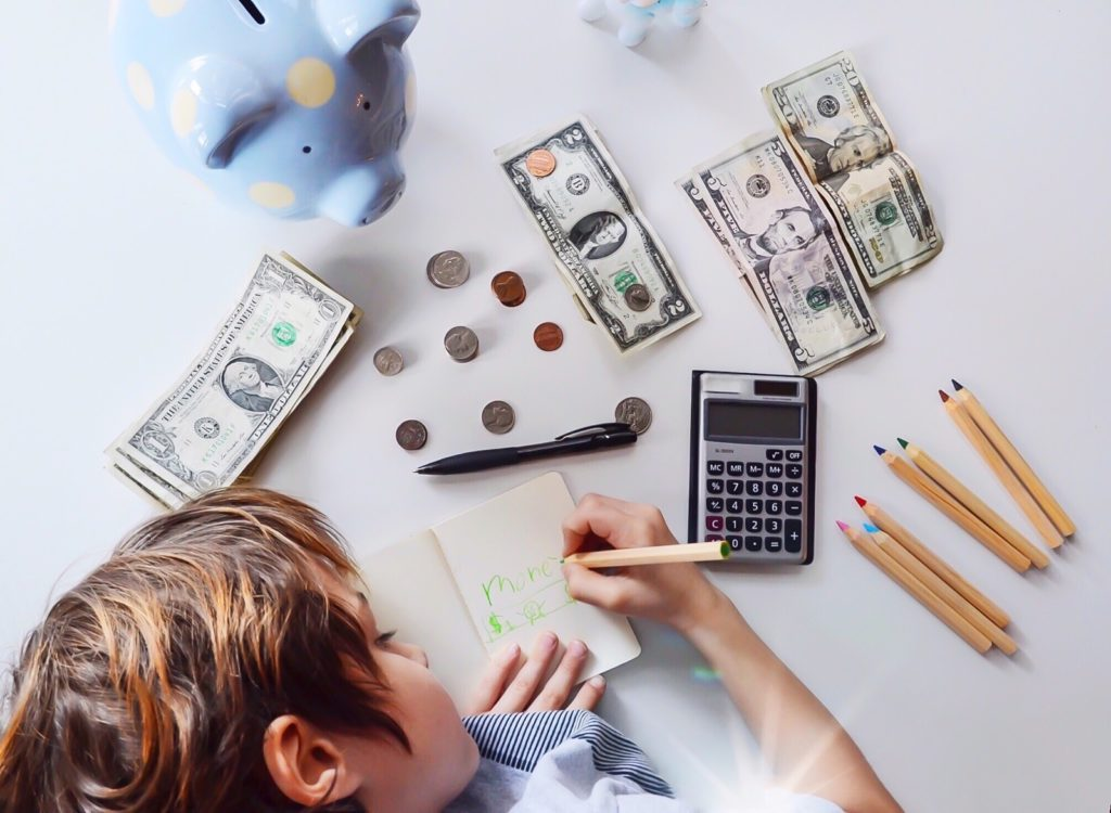 College savings with kids and a piggy bank and money