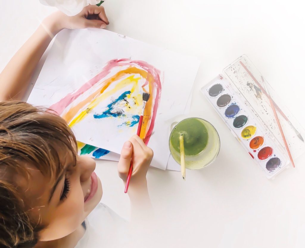 painting rainbows with watercolors.