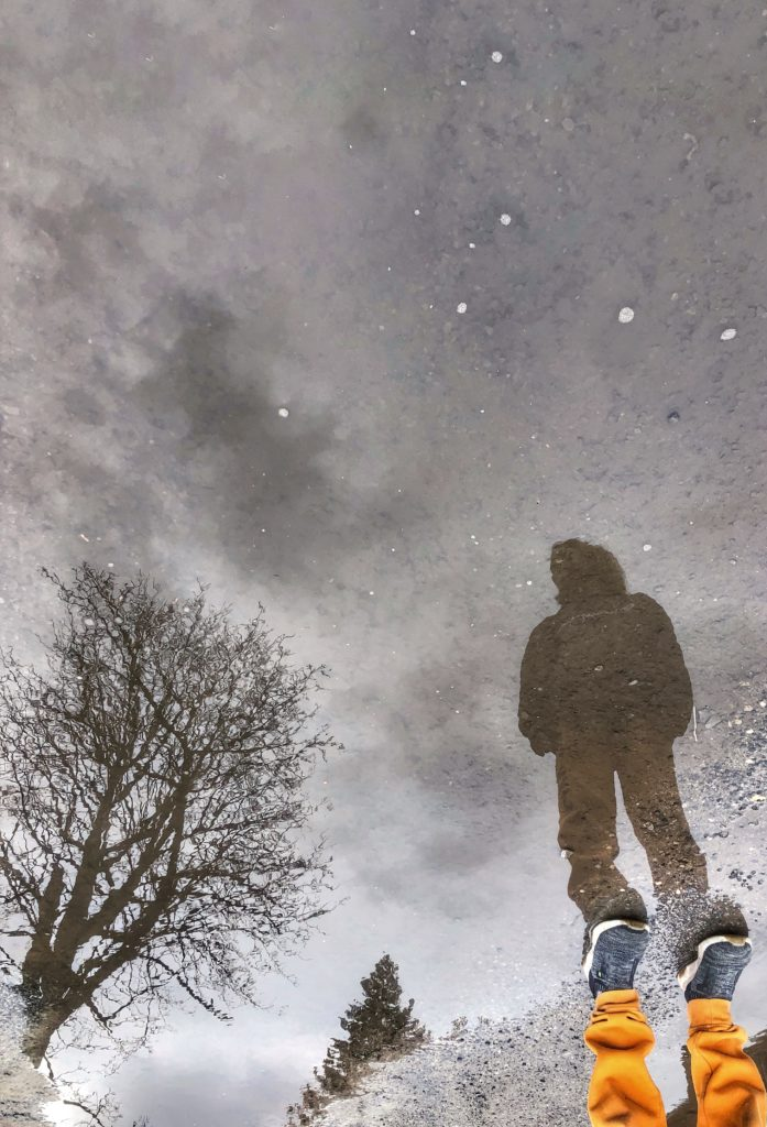 reflection photo in a puddle